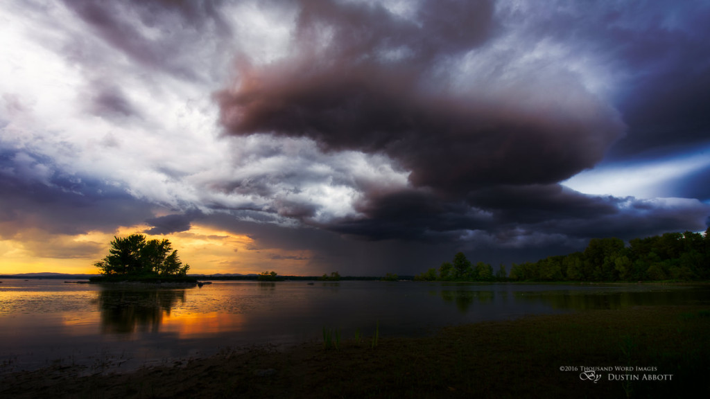 "© 2016 Thousand Word Images by Dustin Abbott  I took this one during a summer storm in August last year.  The sky was low, brooding, and full of darknesss on one side, but there was a patch of warm, golden light breaking through.  I waited until it lined up with the island, and I was able to capture the invading storm on the right contrasting with the summer warmth on the right.  The massive cloud formation reminded me of some massive alien ship descending to invade, hence the title.  Technical Information: Canon EOS 6D, Tamron SP 15-30mm f/2.8 Di VC USD, Processed in Adobe Lightroom CC, Photoshop CC, and Alien Skin Exposure X  (use code ""dustinabbott"" to get 10% off)   Want to know more about me or make contact?  Take a look at my website and find a lot of ways to connect and view my work."